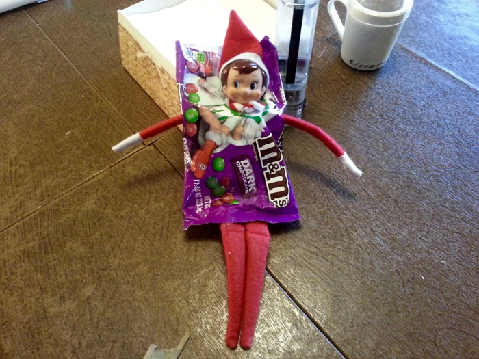 Apparently our Elf on the Shelf likes M&M's.