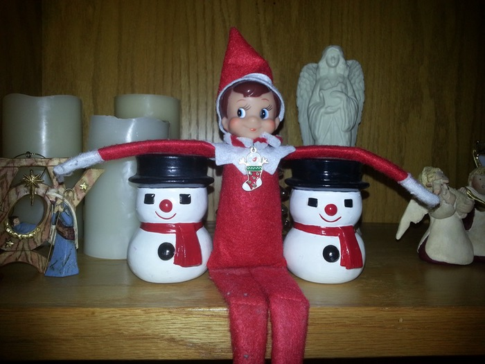 Today our elf was hanging out with his buddies... the snowmen!