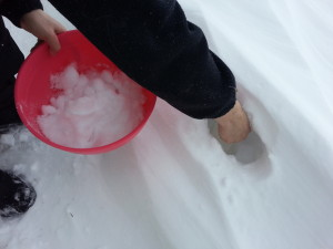 Scooping snow for snow ice cream