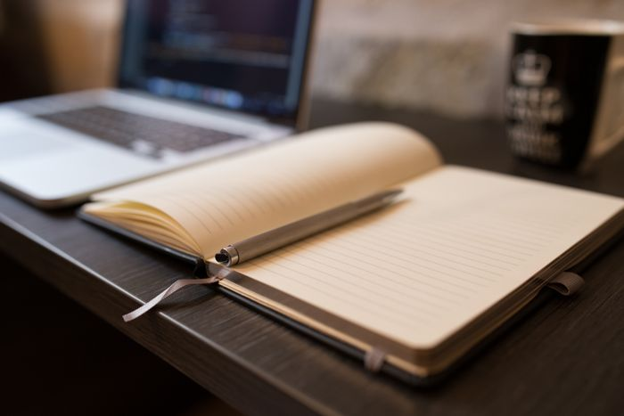 blank notebook and laptop