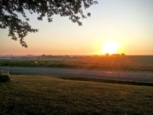 Sunrise over Iowa cornfield