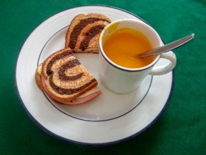 Grilled apple, cheese, and ham sandwich with squash apple soup