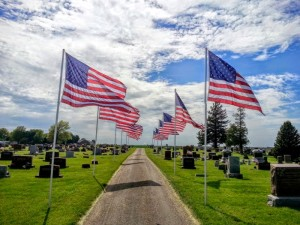 American Flags Flying In A Cemetary