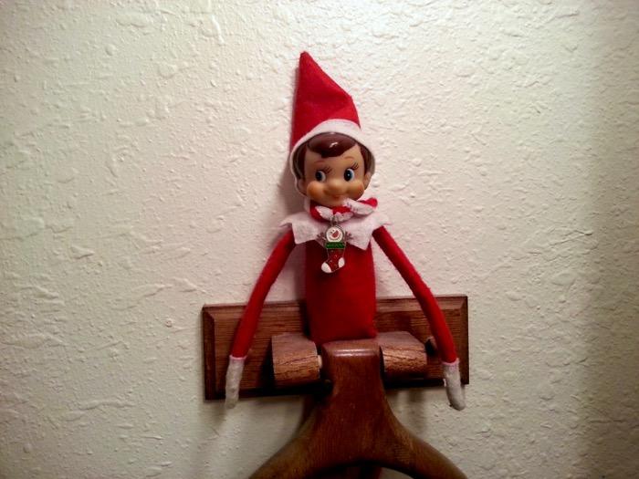 Elf on the Shelf in a Towl Rack