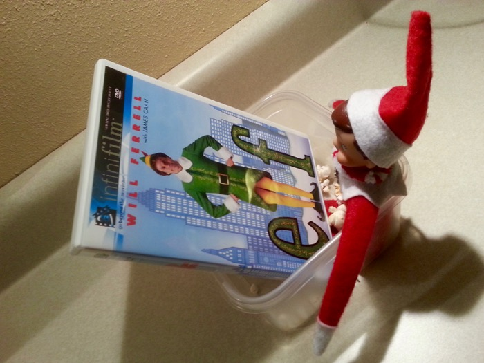 Our Elf camping out in a bowl of popcorn with the Elf DVD.