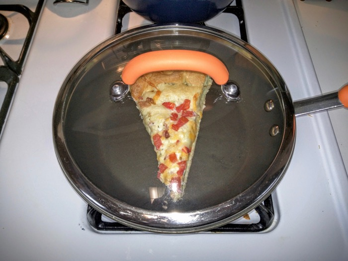 Reheating pizza in a pan on the stove