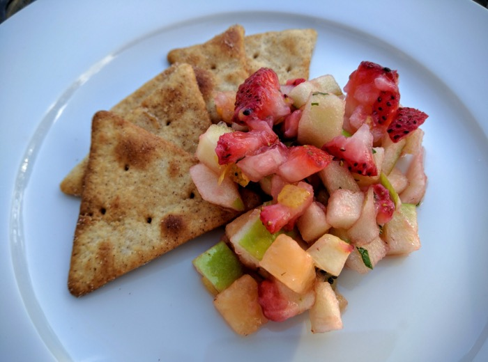Fruit salsa with sugar and cinnamon pita chips