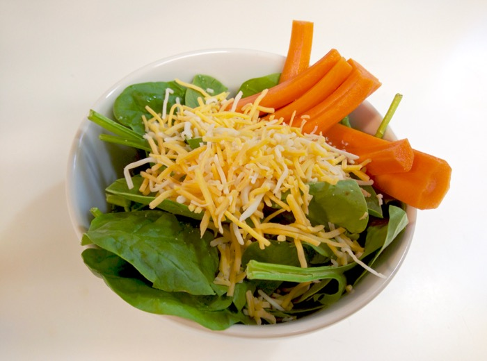 Spinach salad with cheese and carrots
